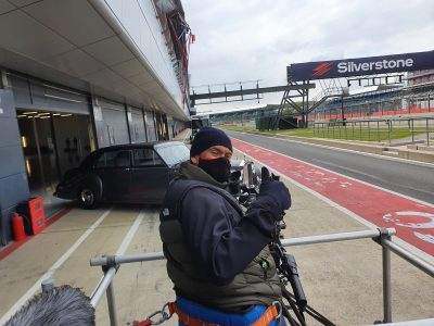 Simon Cox cameraman in tracking car
