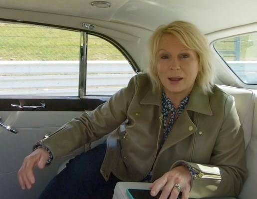 Jennifer Saunders in the passenger compartment of a Rolls Royce Phantom V